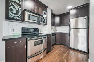 Photo 3: 305 1530 16 Avenue SW in Calgary: Sunalta Apartment for sale : MLS®# A1131555