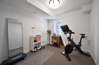 Photo 4: 115 41 Avenue SW in Calgary: Parkhill Row/Townhouse for sale : MLS®# A1100085