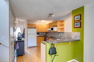 Photo 4: 418 Coral Cove NE in Calgary: Coral Springs Row/Townhouse for sale : MLS®# A1121739