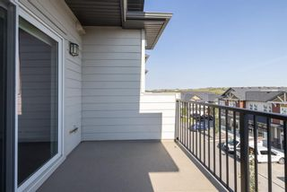Photo 24: 9308 101 Sunset Drive: Cochrane Apartment for sale : MLS®# A1141889