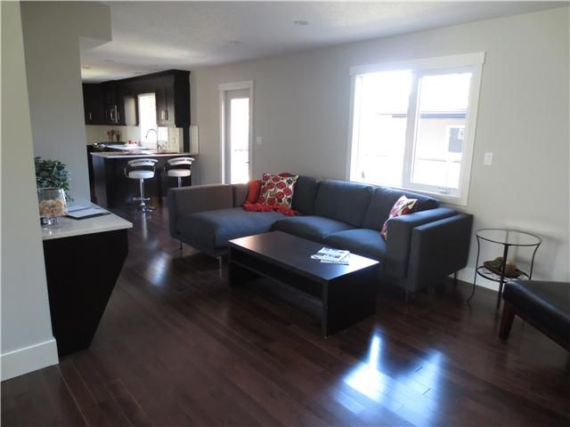 Photo 13: Photos: 1048 LAKE TWINTREE Drive SE in Calgary: Lake Bonavista Residential Detached Single Family for sale : MLS®# C3641174