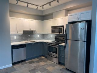 """Photo 1: 211 2511 KING GEORGE Boulevard in Surrey: King George Corridor Condo for sale in """"PACIFICA"""" (South Surrey White Rock)  : MLS®# R2562208"""