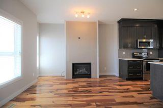 Photo 11: 296 Silverado Plains Park SW in Calgary: Silverado Row/Townhouse for sale : MLS®# A1065666