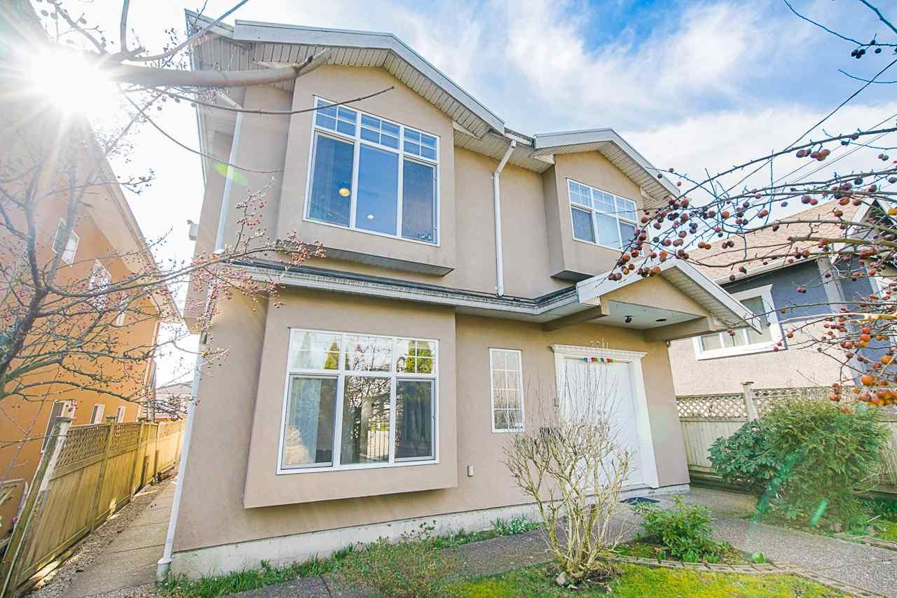 Main Photo: 7711 CANADA Way in Burnaby: Edmonds BE House for sale (Burnaby East)  : MLS®# R2550186