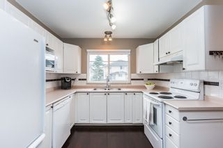 """Photo 5: 6 2458 PITT RIVER Road in Port Coquitlam: Mary Hill Townhouse for sale in """"SHAUGHNESSY MEWS"""" : MLS®# R2143151"""