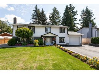 """Photo 1: 3952 205B Street in Langley: Brookswood Langley House for sale in """"Brookswood"""" : MLS®# R2486074"""