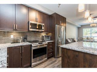 """Photo 2: 210 6490 194 Street in Surrey: Clayton Condo for sale in """"WATERSTONE ESPLANADE GRANDE"""" (Cloverdale)  : MLS®# R2603405"""