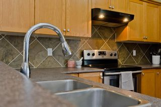Photo 13: 205 2006 LUXSTONE Boulevard SW: Airdrie Row/Townhouse for sale : MLS®# A1010440