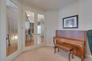 Photo 7: 52 Springbluff Lane SW in Calgary: Springbank Hill Detached for sale : MLS®# A1043718