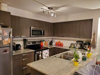 "Photo 7: 318 13883 LAUREL Drive in Surrey: Whalley Condo for sale in ""Emerald Heights"" (North Surrey)  : MLS®# R2430952"