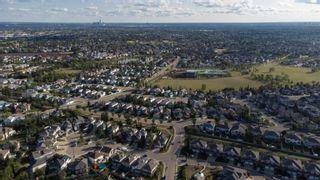 Photo 47: 124 CASTLE Drive in Edmonton: Zone 27 House Half Duplex for sale : MLS®# E4260271