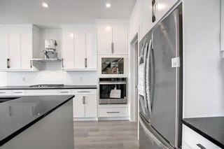 Photo 8: 126 Creekside Way SW in Calgary: C-168 Detached for sale : MLS®# A1144468