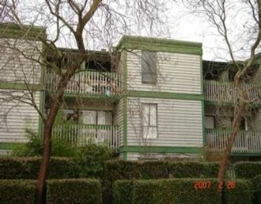 """Main Photo: 1545 E 2ND Ave in Vancouver: Grandview VE Condo for sale in """"TALISHAN WOODS"""" (Vancouver East)  : MLS®# V635596"""