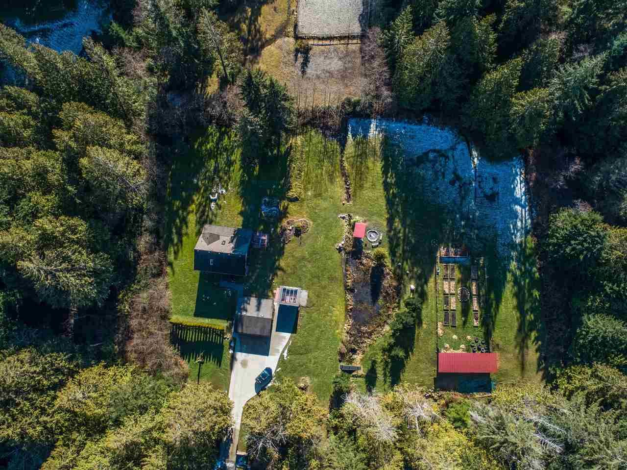 1215 Chaster Rd. 2 acres in central Gibsons - close to all amenities but feels like country!  Hobby farm, gardeners dream, equestrian estate; possibility to subdivide. Ask for information package.