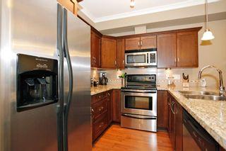 "Photo 11: 204 20286 53A Avenue in Langley: Langley City Condo for sale in ""Casa Verona"" : MLS®# F1428977"