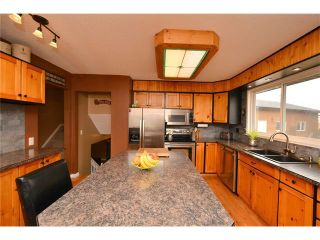 Photo 8: 34 GLENPATRICK Place: Cochrane House for sale : MLS®# C4055156