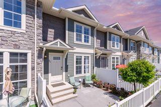 Photo 1: 31 AUBURN BAY Common SE in Calgary: Auburn Bay Row/Townhouse for sale : MLS®# A1118807