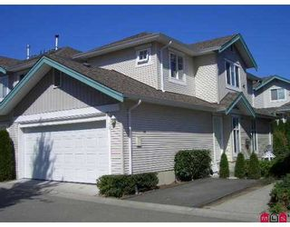 """Photo 1: 6747 137TH Street in Surrey: East Newton Townhouse for sale in """"Primrose Lane"""" : MLS®# F2620760"""