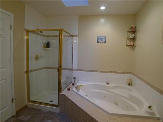 Photo 11: 1409 1 Street NE in Calgary: Crescent Heights Townhouse for sale : MLS®# C3648539