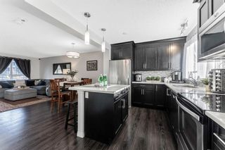 Photo 10: 61 Auburn Meadows View SE in Calgary: Auburn Bay Semi Detached for sale : MLS®# A1081064