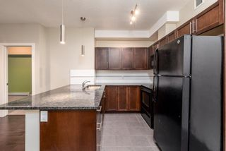 Photo 4: 2129 604 East Lake Boulevard NE: Airdrie Apartment for sale : MLS®# A1106978