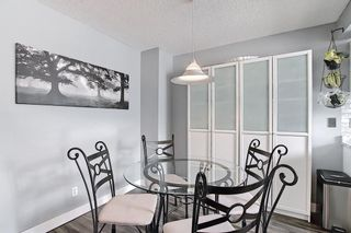 Photo 6: 104 7172 Coach Hill Road SW in Calgary: Coach Hill Row/Townhouse for sale : MLS®# A1097069