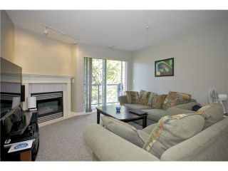 """Photo 4: 207 20277 53 Avenue in Langley: Langley City Condo for sale in """"Metro II"""" : MLS®# F1446990"""