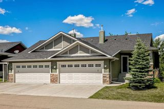 Photo 1: #7 925 Imperial Drive: Turner Valley Semi Detached for sale : MLS®# A1122874