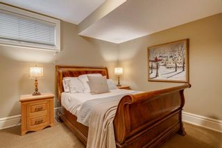 Photo 38: 111 Elmont Rise SW in Calgary: Springbank Hill Detached for sale : MLS®# A1099566