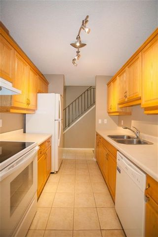 Photo 5: 189 CALLINGWOOD Place in Edmonton: Zone 20 Townhouse for sale : MLS®# E4246325