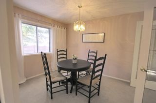Photo 18: 15 Coach Side Terrace SW in Calgary: Coach Hill Row/Townhouse for sale : MLS®# A1071978
