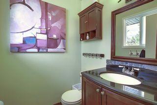 Photo 11: 155 HUNTFORD Road NE in Calgary: Huntington Hills Detached for sale : MLS®# A1016441