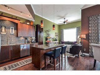 Photo 2: 404 2627 SHAUGHNESSY Street in Port Coquitlam: Central Pt Coquitlam Condo for sale : MLS®# V1073881