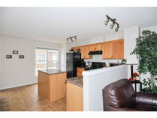 Photo 9: 318 TOSCANA Gardens NW in Calgary: Tuscany House for sale : MLS®# C4116517