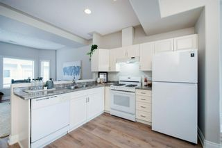 Photo 3: 9 1720 11 Street SW in Calgary: Lower Mount Royal Row/Townhouse for sale : MLS®# A1140590