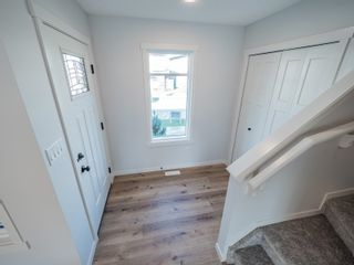 Photo 2: 2615 201 Street in Edmonton: Zone 57 Attached Home for sale : MLS®# E4262205