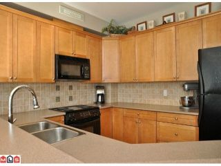 """Photo 2: 9 16760 61ST Avenue in Surrey: Cloverdale BC Townhouse for sale in """"Harvest Landing"""" (Cloverdale)  : MLS®# F1106034"""