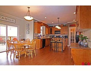 """Photo 2: 6814 198B Street in Langley: Willoughby Heights House for sale in """"ROUTELY WYND"""""""