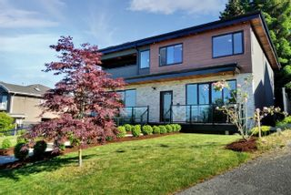 Photo 2: 4040 CURLE Avenue in Burnaby: Burnaby Hospital House for sale (Burnaby South)  : MLS®# R2620629