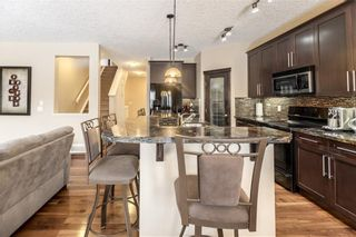 Photo 9: 325 BRIDLERIDGE View SW in Calgary: Bridlewood House for sale : MLS®# C4177139
