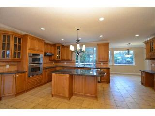 """Photo 6: 2201 HAVERSLEY Avenue in Coquitlam: Central Coquitlam House for sale in """"MUNDY PARK"""" : MLS®# R2141892"""