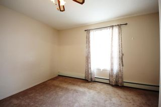 Photo 14: 404 4514 54 Avenue: Olds Apartment for sale : MLS®# A1130006