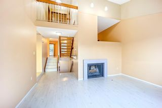 Photo 4: 7050 Edgemont Drive NW in Calgary: Edgemont Row/Townhouse for sale : MLS®# A1108400