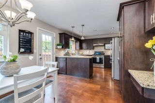 Photo 10: 4031 WEDGEWOOD Street in Port Coquitlam: Oxford Heights House for sale : MLS®# R2556568