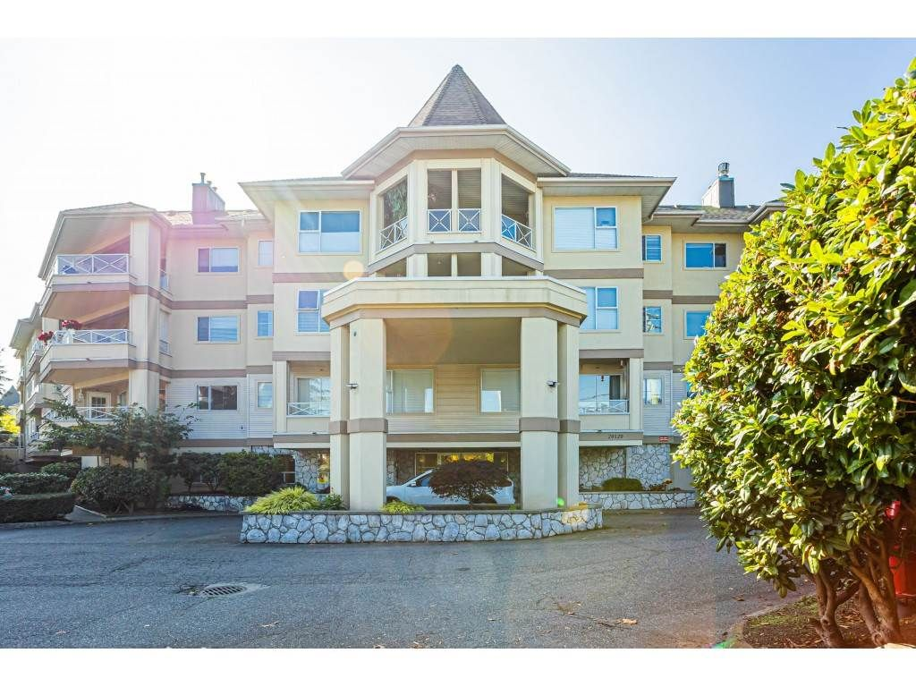 "Main Photo: 302 20120 56 Avenue in Langley: Langley City Condo for sale in ""Blackberry Lane 1"" : MLS®# R2506243"