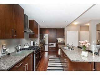 Photo 2: # 208 16477 64TH AV in Surrey: Cloverdale BC Condo for sale (Cloverdale)  : MLS®# F1405334