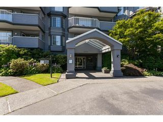 """Photo 2: 201 5375 205 Street in Langley: Langley City Condo for sale in """"Glenmont Park"""" : MLS®# R2482379"""