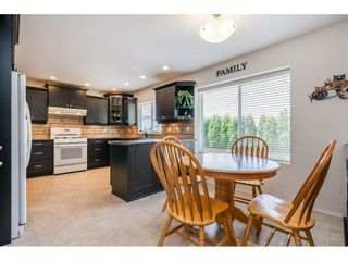 """Photo 8: 6495 180 Street in Surrey: Cloverdale BC House for sale in """"Orchard Ridge"""" (Cloverdale)  : MLS®# R2396953"""