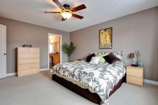 Photo 12: 131 Cougar Plateau Circle SW in Calgary: 2 Storey for sale : MLS®# C3614218