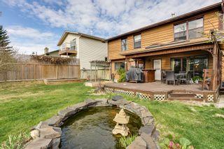 Photo 3: 156 Coachwood Cr SW in Calgary: Storey for sale : MLS®# C3617157